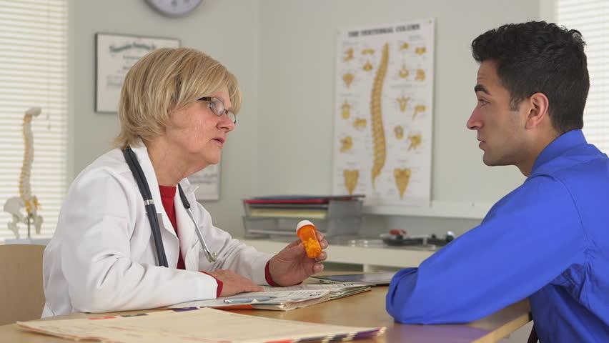 Doctor explaining medications